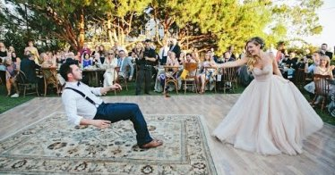 Bride puts a spell on her magician groom during first dance